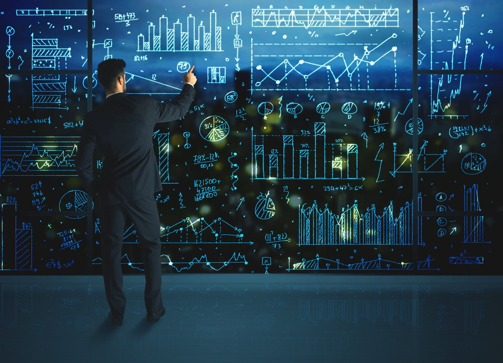 Businessman drawing business statistics on glass wall-2