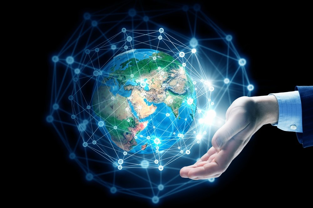 Global connection concept with digital planet in hands. Elements of this image are furnished by NASA