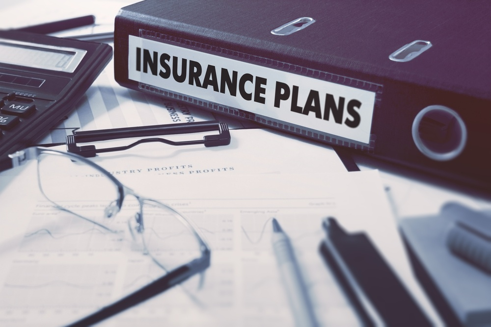 Insurance Plans - Ring Binder on Office Desktop with Office Supplies. Business Concept on Blurred Background. Toned Illustration.-3