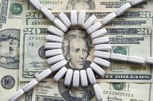 Ring of light-colored tablets on U.S. $20 bills