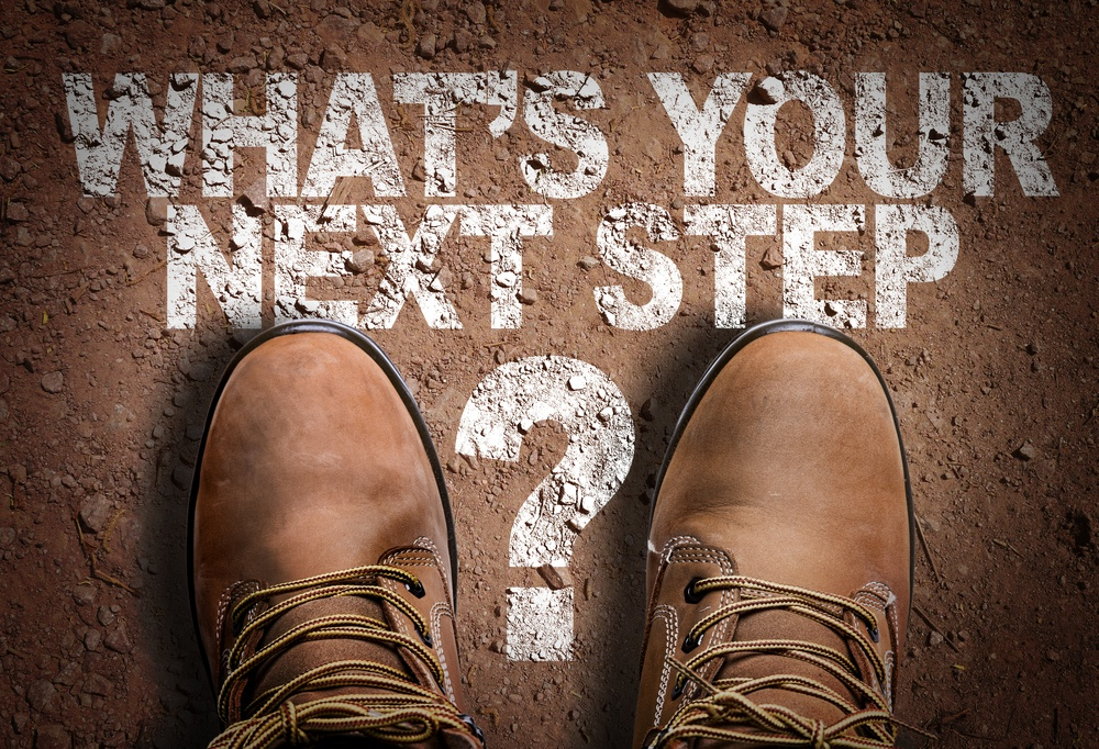 Top View of Boot on the trail with the text Whats Your Next Step?